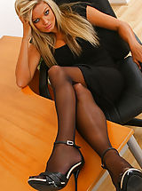 Naughty Jennifer lets her black minidress hit the floor as she strips in her office