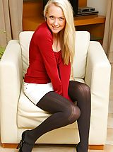 Sexy blonde Lucy looks adorable as she removes her tight red top and white mini skirt to reveal her black pantyhose