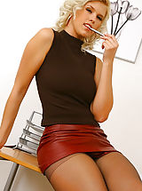Naughty Secretary, Saucy secretary Amy G loves to make a good impression in her red leather miniskirt