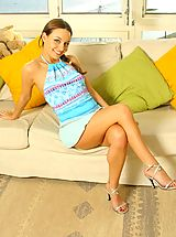 Carla in a gorgeous blue summer outfit with stockings.