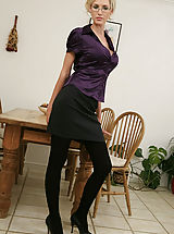 Stunning blonde secretary Andrea in black pantyhose.