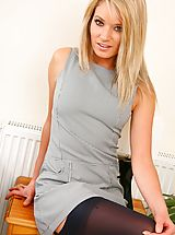 Stockings Pics: The gorgeous Emma C stripping from her grey Secretary Outfit and black stockings and suspenders