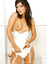 Only Tease Pics: Sexy brunette Lou L wearing a nurse's uniform with tan stockings