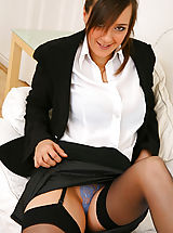 Stunning executive secretary Nadia E finishes off her work and then undresses from her sexy skirt suit