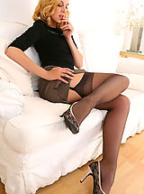 Miniskirt Tease, Stunning beauty secretary slips out of her outfit with gorgeous lingerie.