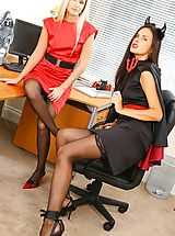 Two Halloween secretaries in tight minidresses with matching high heels.