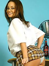 Naughty Office, Carla in sexy college uniform with tartan skirt.