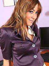 Sexy secretary in a purple satin skirt suit and heels.
