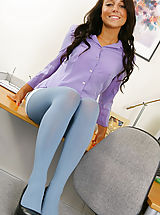 Pantyhose Pics: Beautiful brunette Bethany in a smart office outfit with blue pantyhose.