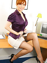 Classy Legs, Saucy secretary in smart office outfit with light lingerie and stockings.