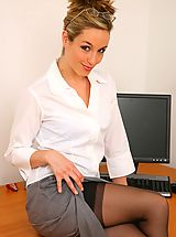 Sexy secretary Mel seductively teases her way from her outfit in the office revealing her gorgeous blue lingerie