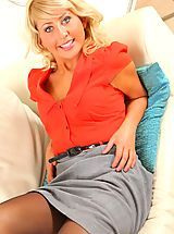 Gorgeous blonde Sophie Star looks stunning as she removes her secretary outfit