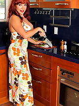 Curvaceous housewife shows off her huge tits in a sexy maxi dress