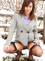 Only Tease Pics: Emma H looking stunning in the snow in her sexy secretary outfit.