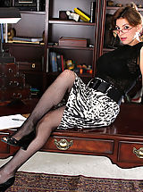 Long Legs, Valarie, Anilos Latina Valarie slips off her office attire and spreads her pussy atop her desk