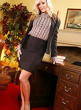 Sexy Secretary, Blonde slips out of her tight black knee-length skirt suit and reveals her sexy lingerie.