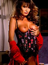 Suze Randall Pics: Sexy Buxom brunette April O'Hara makes incredible shapes to Suze's incredible erotic eye.