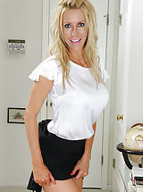 Legs, Pretty aged milf Pamela Rivett exposes large fake boobies.