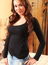 The lovely Naomi Black teases her way out of her tight top and denim miniskirt.