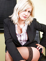Sexy executive cougar Laurita offers upskirt views and reveals her curvy body during break time