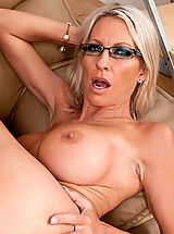 Smokin hot milf Emma Starr rocks a young studs world