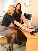 Sexy Secretaries, Bebe and Jenna J lock themselves in their office to strip each other out of their smart work clothes.