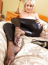Long Legs, Lucy Anne in a strapless pink top, skin tight black leggings and matching high heels.