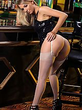 Hot Legs, Hayley-Marie flashes her lacey white lingerie and stockings from beneath her tight black dress.