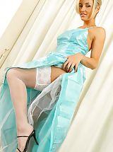 Mel looking gorgeous in a stunning evening dress and stockings.