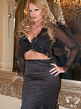 Kelly rubs on her clit in black thigh highs and black see thru skirt.