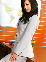 Beautiful brunette secretary Laura A strips from her cute grey suit and purple shirt to give us a glimpse of her sexy white lingerie Non Nude