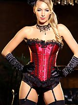 Busty blonde burlesque dancer shows she is even better at teasing off the stage than she is on it, as she slips out of her show costume corset.