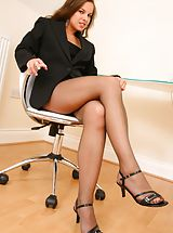 Open Legs, Michaela looks amazing as she seductively teases her way out of her gorgeous pinstripe jacket and mini dress to reveal her sexy brown pantyhose Non Nude
