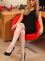 Naughty Secretary, Beth looking smart in this sophisticated black dress and white hosiery.