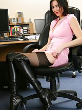 Naughty Secretary Carole in pink minidress