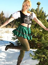 Only Tease Pics: Joceline looking stunning in fraulein outfit with boots and pantyhose.