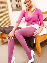 Blonde Kara looks fantastic wearing pink opaque pantyhose that compliment her pink top and tight miniskirt.