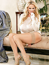 corset and stockings, Kelly wears a see thru top and rubs on her clit on a chaise lounge.
