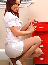 Long Legs, Kinky redhead teases her way out of her work clothes and poses over her desk.