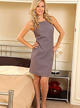 Busty Secretary, Elle is wearing a shift dress with tan stockings