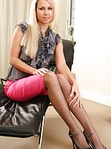 Hot Legs, Gorgeous blonde wearing a grey opaque blouse with a long pink skirt.