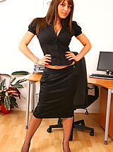Sexy secretary Jenna seductively strips from her outfit revealing her naughty blue underwear