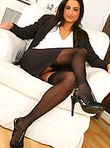 Sexy Legs, Gorgeous brunette Isla looks stunning in her sexy brown secretary outfit