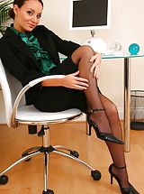 Stilletto Heels, Gorgeous brunette Carla shows off the stunning body beneath her office clothes.