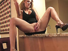 Anne plays with her pussy