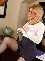 Upskirt Pics: Busty blonde teacher seduces her big cocked student on her desk for hot sex.