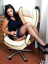 Secretary Pics: Big tits and nylons in the office!