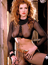 Julia Hayes gets kinky with see through stockings and fishnets and her fiery hair gone wild!