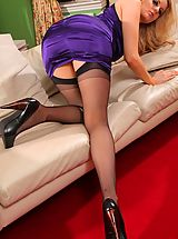 Between Her Legs, Amber Leigh slips out of her stunning, purple evening dress and poses in just her stockings.