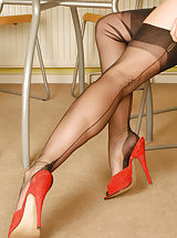 Chilling out at the breakfast table is busty brunette babe Rebekah.. She's another of our girls who is a big fan of the real Harmony Point point heel nylons in 20 denier!